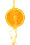 Orange sloce and juice splash Royalty Free Stock Images