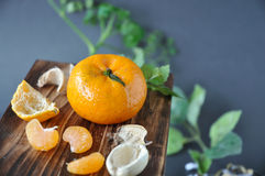 Orange with Small Pieces on Wooden Board Royalty Free Stock Photos