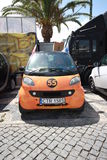 Orange Smart forTwo F2. Smarts parked in Smart Times 2014 event in cascais portugal http://www.smarttimes14.com Royalty Free Stock Image