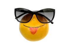 Orange with Smiley. In sunglasses shows tongue Royalty Free Stock Photography