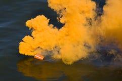 Orange smoke. A distress signal at sea Stock Photo
