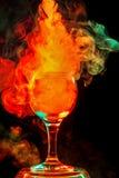 Orange smoke in a glass. Halloween. Royalty Free Stock Photo