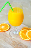 Orange smoothie. Orange fresh or orange smoothie in a hot summer day or a spring day Stock Photography