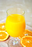 Orange smoothie. Orange fresh or orange smoothie in a hot summer day Royalty Free Stock Photo
