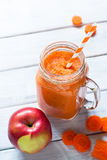 Orange smoothie from carrot and apple. Stock Image