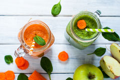 Orange smoothie from carrot and apple. Royalty Free Stock Photography