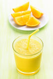 Orange smoothie in glass Royalty Free Stock Image