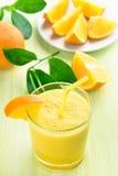 Orange smoothie in glass Royalty Free Stock Photos