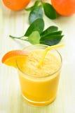 Orange smoothie in glass Royalty Free Stock Image