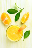Orange smoothie in glass Stock Images