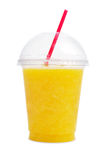 Orange smoothie in plastic cup Stock Photography