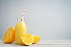 Orange smoothie in retro bottle Royalty Free Stock Photos