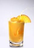 Orange Smoothie Served with Orange Slice. On gray Stock Image