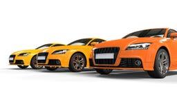 Orange snabba bilar Arkivfoto