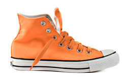 Orange sneakers isolated. Orange sport shoe, isolated on white Royalty Free Stock Photography
