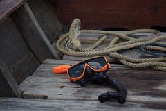 Orange snorkel scuba mask in a boat Stock Photo