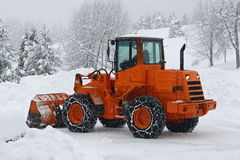 Orange snow plows to work clearing the snow stock photo