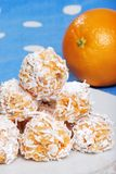 Orange snowball cookies with fruit in the backgrou Royalty Free Stock Image