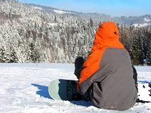 Orange snowboarder. Resting on the slop stock images