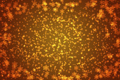 Orange snowflakes background or frame Royalty Free Stock Photos