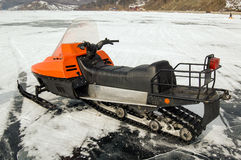 Orange snowmobile on ice. Orange snowmobile on the ice of Lake Baikal Stock Image