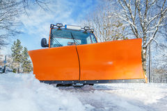 Orange snowplough Stock Photography