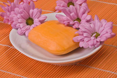 Orange soap with blooms Stock Photos