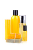 Orange soaps and lotions. Handmade herbal soaps and lotions in orange bottles on white background Royalty Free Stock Image