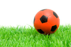 Orange soccer ball on grass Stock Photo