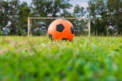 Orange soccer ball Stock Image