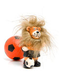 Orange soccer ball and lion Stock Photo