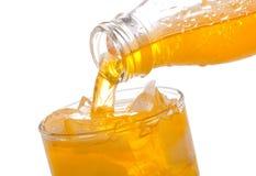 Orange soda pouring into glass Stock Photos