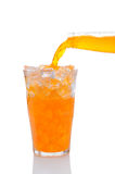 Orange Soda Pouring into Glass of Ice Royalty Free Stock Photography
