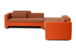 Orange sofa Stock Photos
