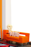 Orange sofa. Made from plush with pillows Royalty Free Stock Image