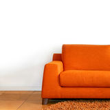 Orange sofa. Comfort orange textile sofa in living room Stock Photo