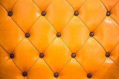 orange sofa Fotografering för Bildbyråer