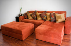 Orange sofa. Comfortable orange velvet couch with patterned pillows Stock Photo