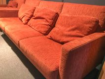 Orange sofa and black wall. In living room Royalty Free Stock Photos