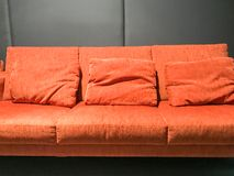 Orange sofa and black wall. In living room Royalty Free Stock Image