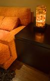 Orange sofa detail. Orange lounge setting with a warm lighting Stock Photography
