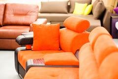 Orange sofa in a furniture shop stock photo