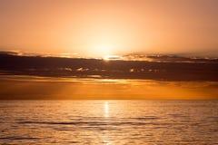 Orange solnedgång över golfen av Mexico av västkusten av Florida Royaltyfria Foton