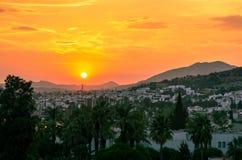 Orange solnedgång över staden av Bodrum, Turkiet Royaltyfria Foton