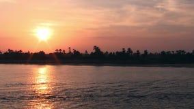 Orange solnedgång på flodNilen arkivfilmer