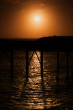 Orange soluppgång på bryggan på Catherine Hill Newcastle Arkivbild