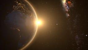 Orange Sonnenaufgang über Erde lizenzfreie stockfotos