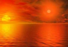 Orange Sonnenuntergang mit zwei Sternen Stockfotos