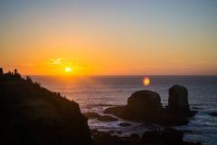 Orange Sonnenuntergang am Strand Stockfotografie