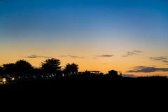 Orange Sonnenuntergang am Strand Stockbild